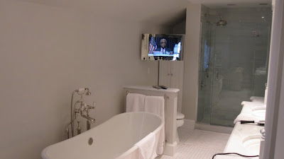 Here we have custom made mirror finished waterproof LCD TV installed in the  bathroom. This