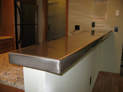 Incroyable Hand Formed Stainless Steel Clad Bar Top.
