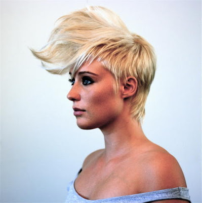 blonde and black hair underneath. Source