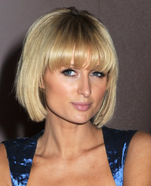 Paris Hilton medium blonde hairstyle with bangs
