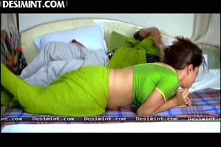 Hot South Indian Actress Malavika Masala Rape Scene Pics : Malavika showing cleavage in blouse, backless pics, navel show on bed