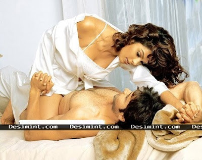 Hot Desi Bollywood actress Mallika Sherawat wearing a white dress seducing emran Hasmi : Desi masala actress