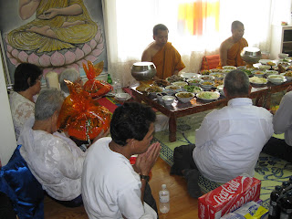 What is the meaning of giving food to the monks?