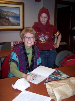 Phyllis Sanford autographing a book for Hava at the HHCC monthly meeting.