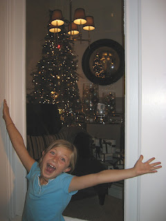 Youngest daughter in front of Xmas display on Labor Day