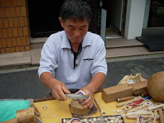Man making wooden spinning tops