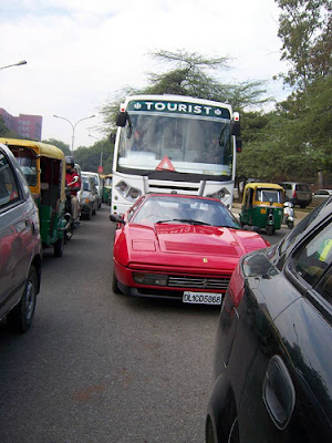 Ferrari in traffic in Delhi capital of India.
