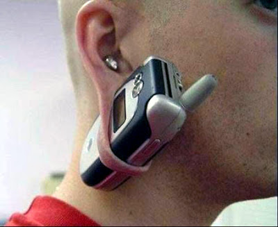 Motorola fan actually wears a cell phone as an earring