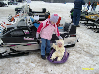 Tristyn x26amp; Maddy at a vintage snowmobile show. That's Tony's 1973 Arctic Cat Panther. Tris with her brand new helmet