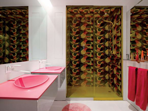 Bathroom-interior-design-by-Karim-Rashid-furnished-with-double-pink-washbasins-white-faucets-mirrors-shower-and-bathroom-accessories