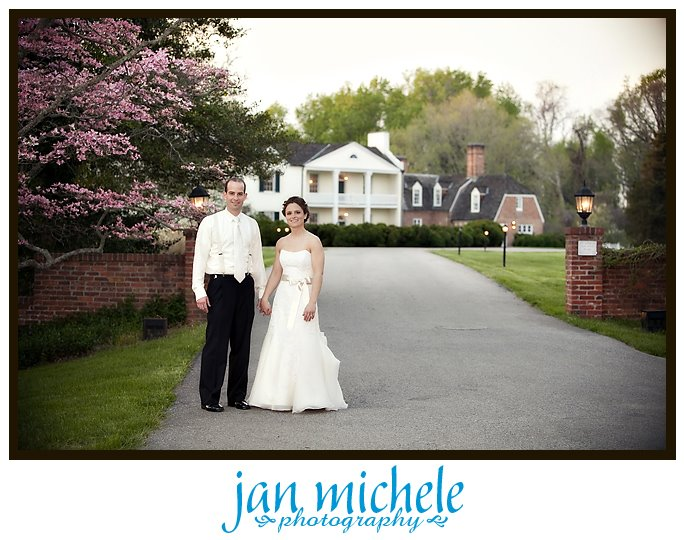 bride and groom in front of Mt. Airy Mansion