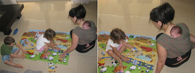 Putting together a jigsaw puzzle while babywearing a newborn baby!