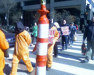 Gitmo protestors crossing K Street