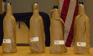 wines wearing brown paper bags