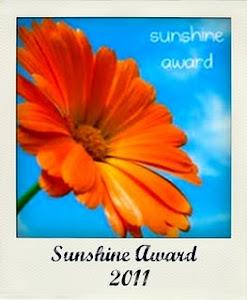 """Prêmio Sunshine Award concedido por indicação do blog """"O Falcão de Jade"""" em 21/01/2011"""