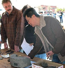 Photo of Gentleman explaining the use of grinding stone