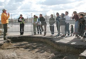 One of the stops along the tour, Chelsea looks on, as Stoyka describes what can be seen at this trench.