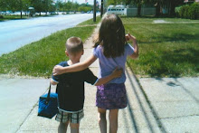 Isn't this precious...Cousins...two of my grandchildren.