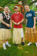 3 of my 4 sons in their grass skirts...