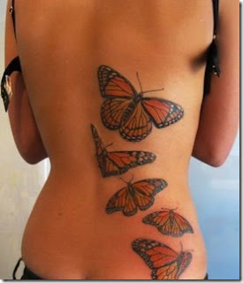 Girl back side butterfly tattoo