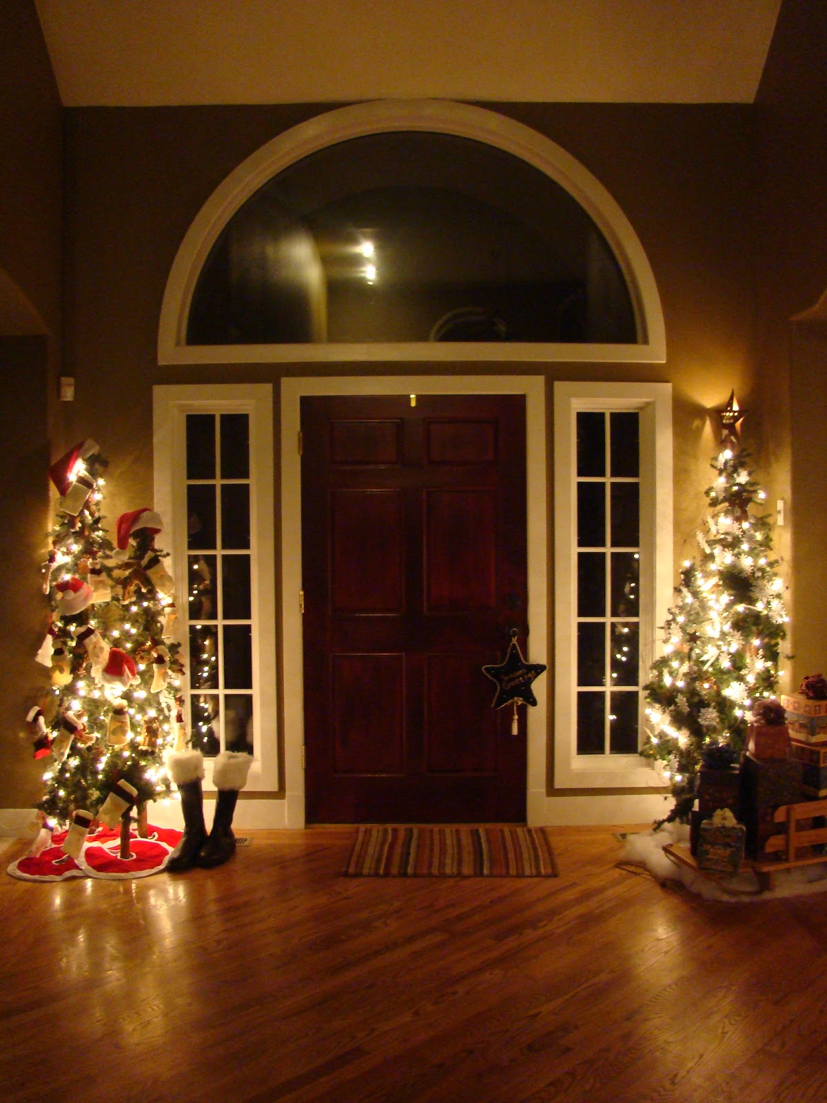 santa tree on the left snowman tree of the right - Entryway Christmas Decorations