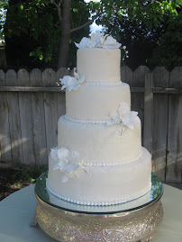 4-tier round fondant with sugar crystals and gumpaste flowers