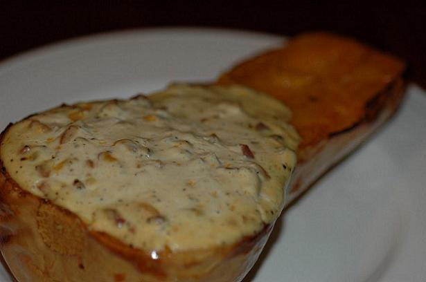 Roasted butternut squash stuffed with cheese, bacon, chorizo and sour cream