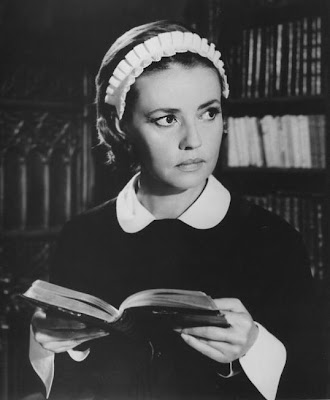 Beautiful Jeanne Moreau reads a book.