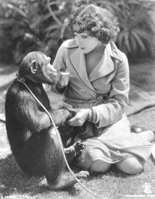Lupe Velez corrupts a monkey with a Camel.