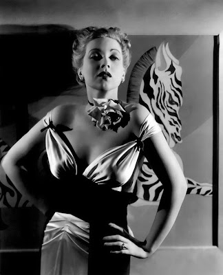 Ann Sothern strikes a pose in grayscale.