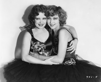 Clara Bow and Joyce Compton share a hug.