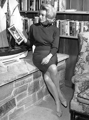 Inger Stevens NEAR some reading materials.