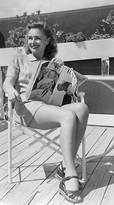 Lovely Miss Donna Reed catching some rays.