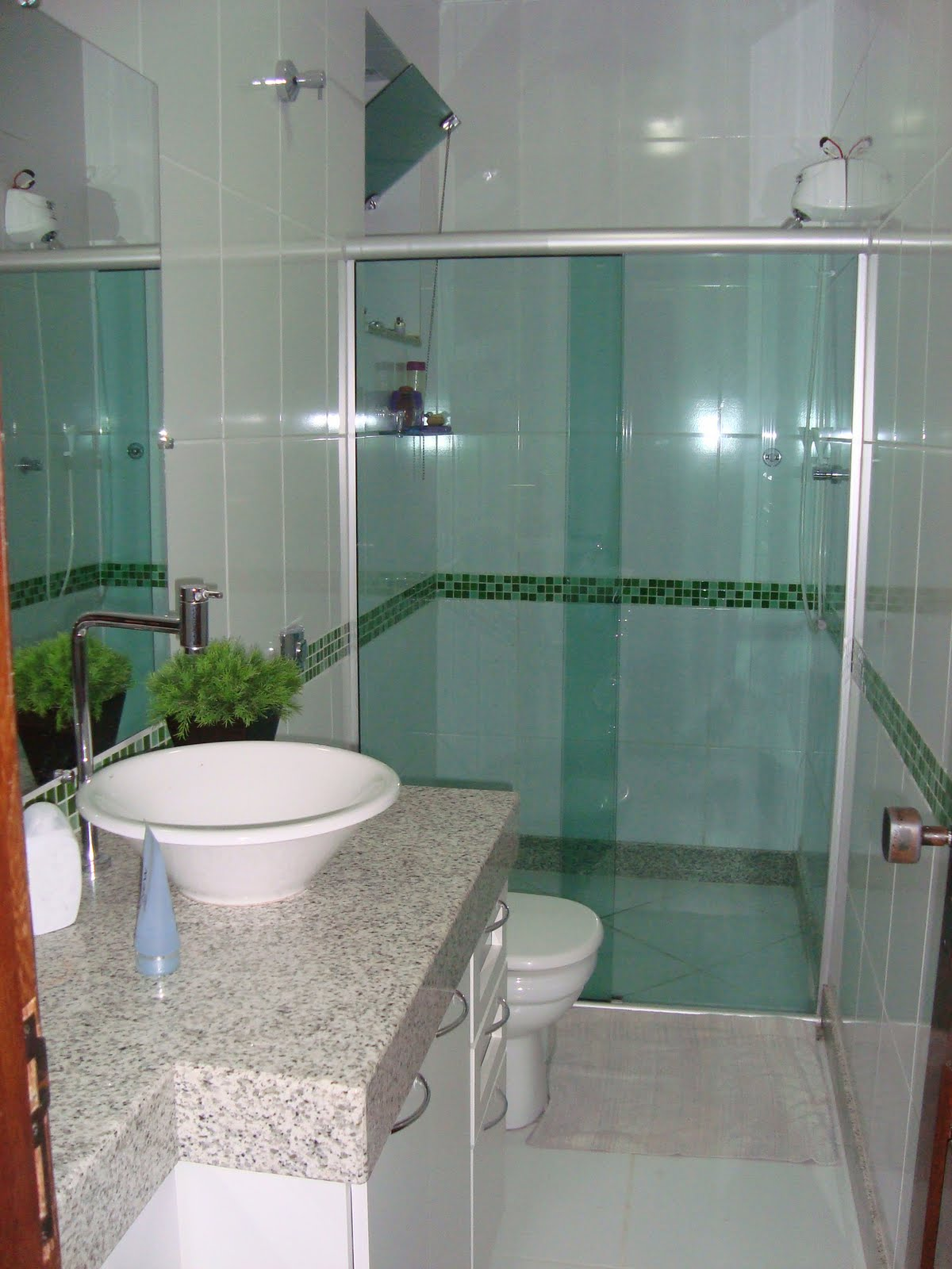 Lígia Araújo Arquitetura e Urbanismo Ltda.: Banheiro Residencial  #773B29 1200x1600 Arquitetura Banheiro Pequeno
