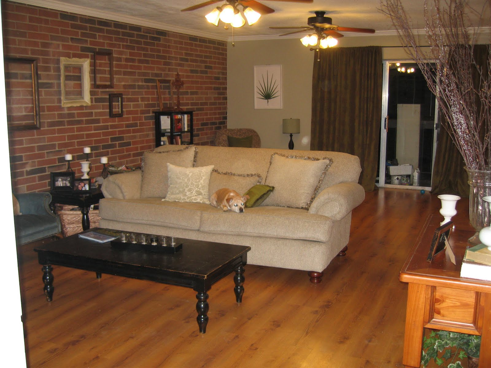 Livingroom with brick wall to kitchen all blog custom for Brick wall interior living room
