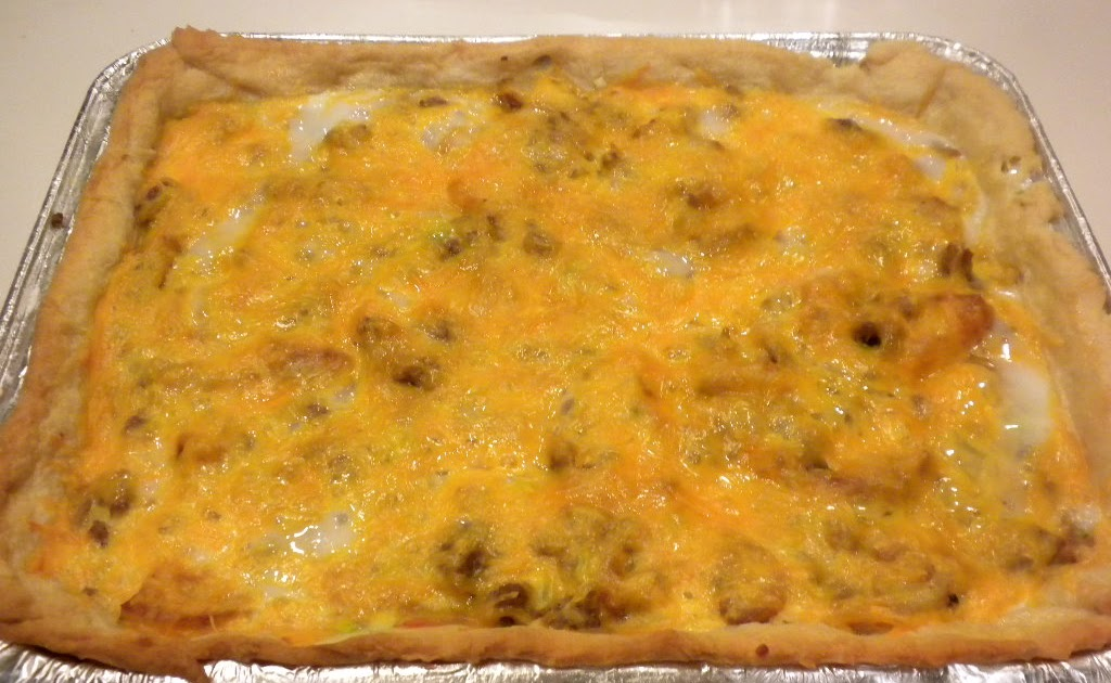 A hearty, flavorful breakfast or dinner. Whenever I have a crowd for breakfast, I like to serve a hearty breakfast casserole. Here's my latest example: Cheesy Egg Crescent Roll Casserole. You make this kind of like a quiche, with refrigerator crescent rolls – the kind that come in a tube.