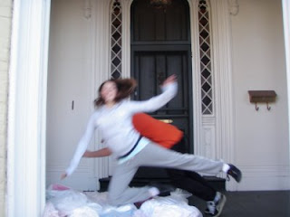 child jumping on pillows