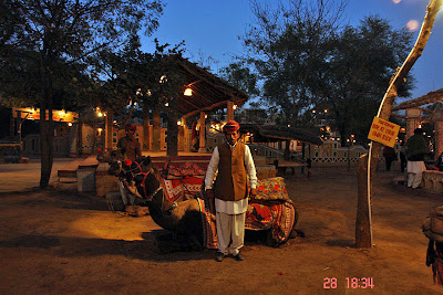 Chokhi Dhaani in Jaipur - A man posing in front of his camel