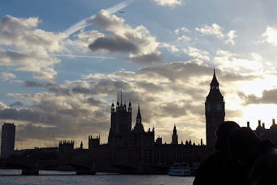 A beautiful view of a partially cloudy sunset over the Thames and Westminster in London