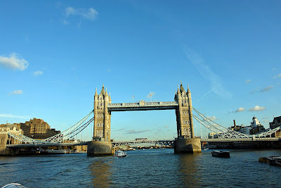 A beautiful view of the Tower Bridge in London against a blue sky