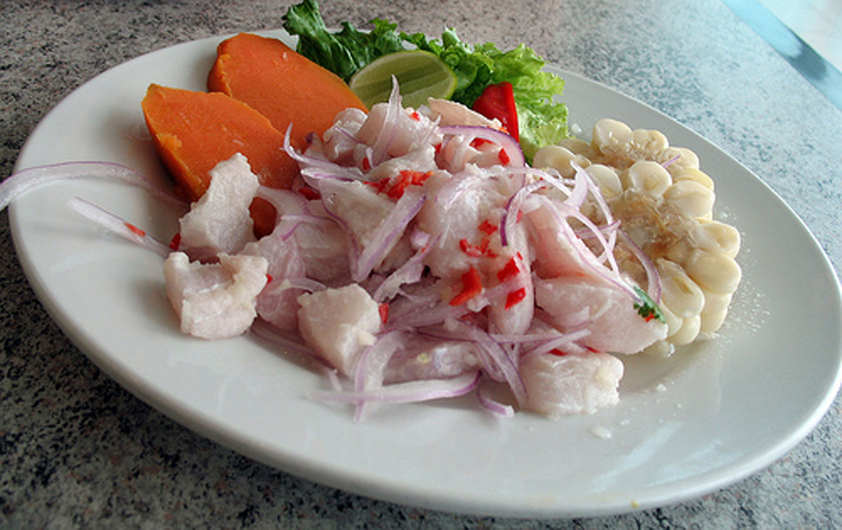 Cebiche is enjoyed with corn, avocado, and sweet potatoes