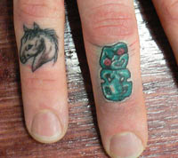 Pony Tiki Finger Tattoos