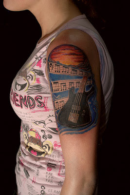 Bass guitar tattoo