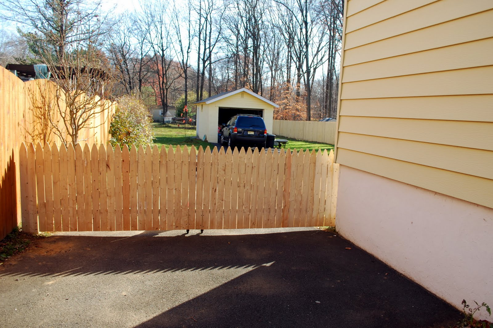 in the little yellow house our fence is finished the driveway