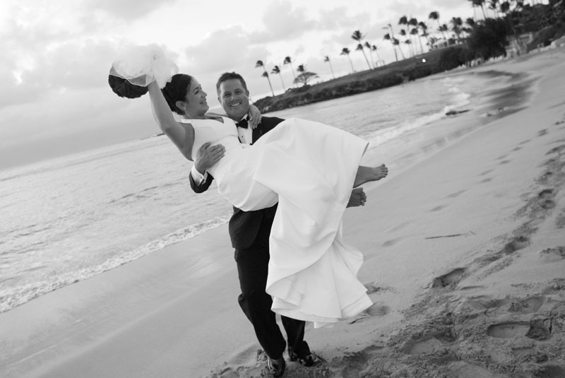 of our wedding couples on the beach and the names of the photographers
