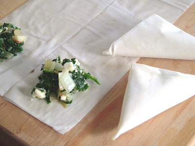 Spanikopita+partially+rolled Day 298: Spanakopita Triangles and Seafood Risotto