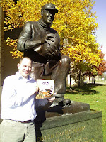 Chris sharing Gid the Kid book with Notre Dame football statue