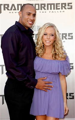 Kendra Wilkinson and Hank Baskett got married Saturday on the lawn of the Playboy mansion, near the wishing well.