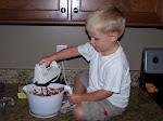 Mason helping make cupcakes