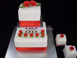 2 tier pilared square cake with red sugar roses.